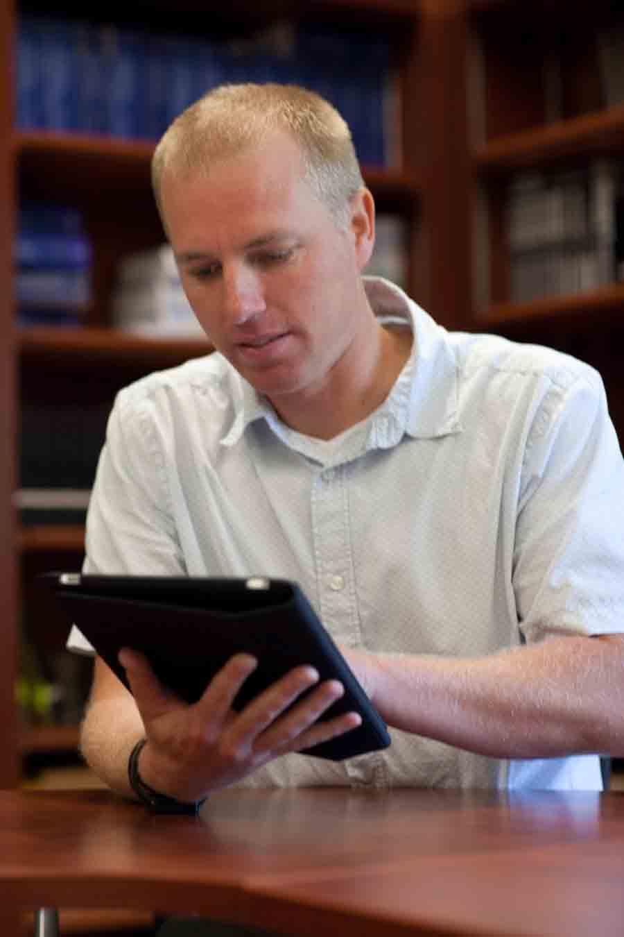 teacher with iPad in the classroom