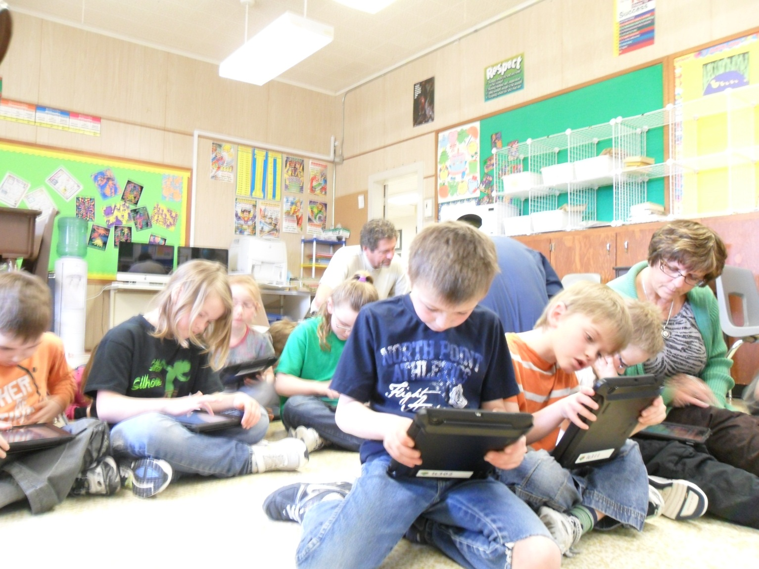 students with iPad in the classroom