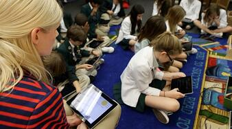 teacher with iPads in schools, classroom technology, school wifi,