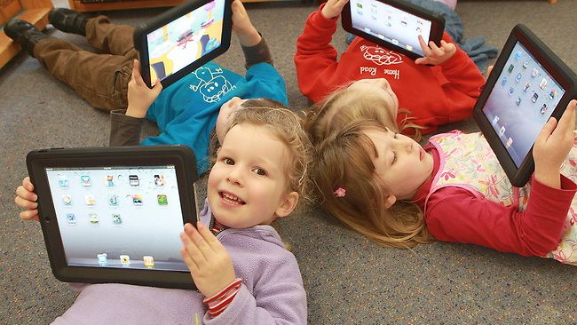 students using iPads in the classroom