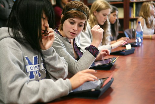 high school students with ipads in the classroom,