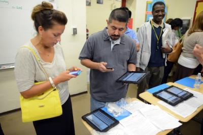 teachers with iPads in the classroom