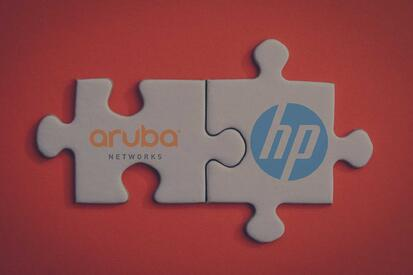 two connected puzzle pieces with an Aruba and HP logo on each