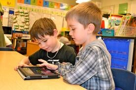 students with technology in the classroom