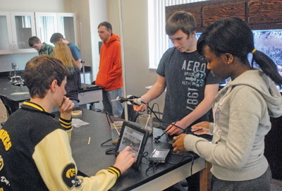 high school students using technology in the classroom
