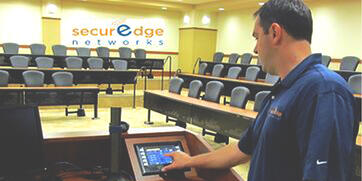 SecurEdge-engineer-working-in-large-conference-room