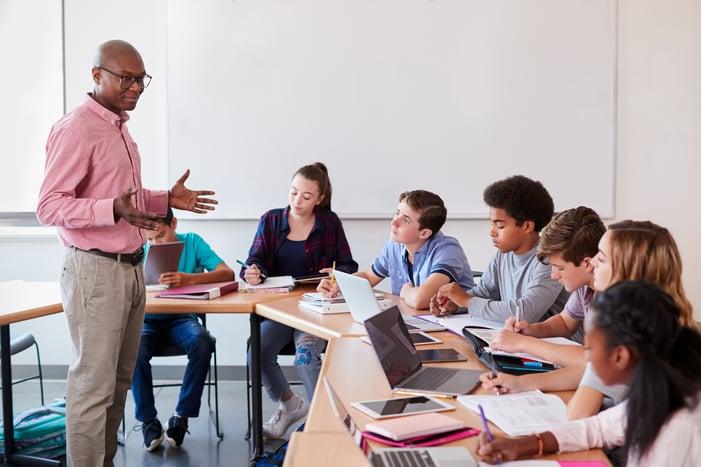 High-School-Teacher-Talking-To-Students