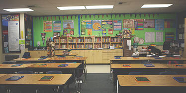ipads-on-students-desks-in-the-classroom