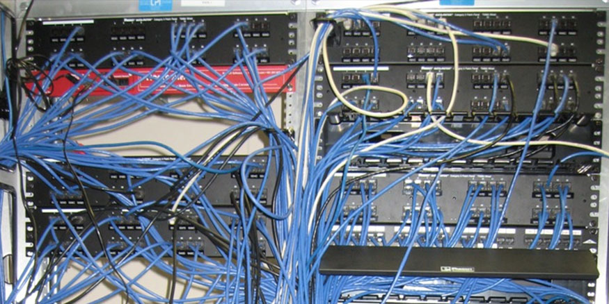 IT closet with cables in disarray