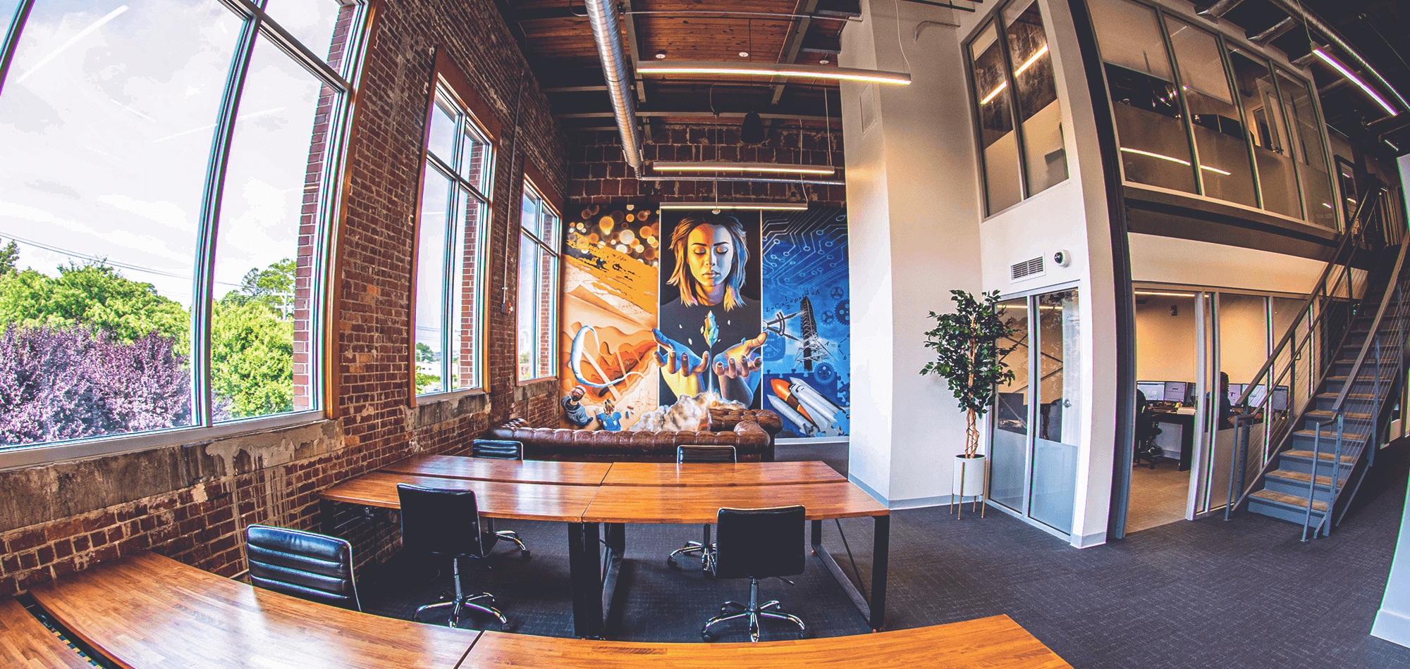 Coworking-space-with-dedicated-desks-and-a-unique-mural-to-spark-creativity